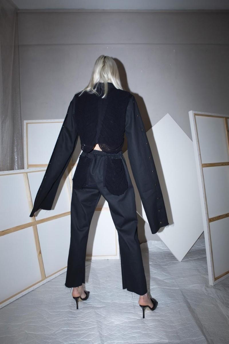 Short jacket, extra long sleeves, metallic silver snaps, distressed back